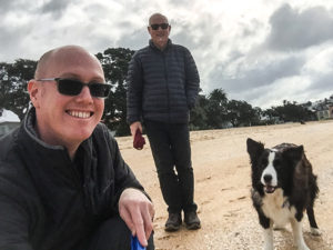 Andrew Christopher and Solo on the beach