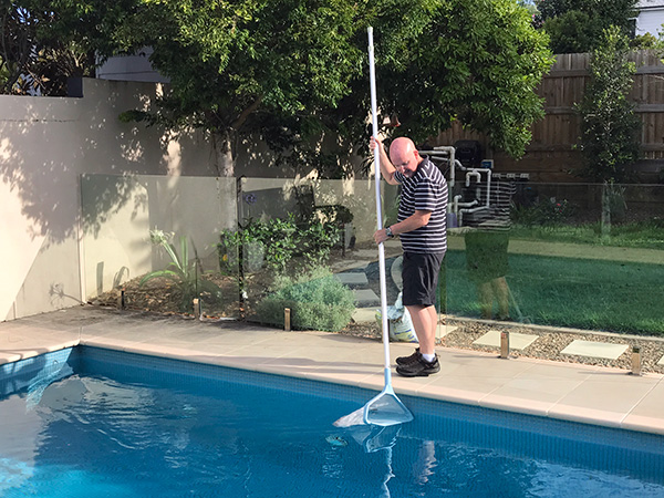 Christopher cleaning the pool in Brisbane