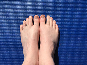 Toes in yoga pose of tadasana