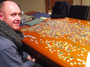 Andrew completing Jigsaw puzzle